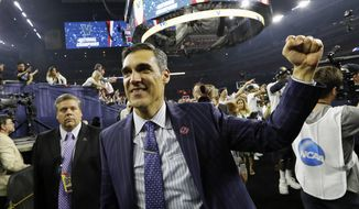 FILE - In this April 4, 2016, file photo, Villanova head coach Jay Wright celebrates after the NCAA Final Four tournament college basketball championship game against North Carolina, in Houston.Villanova coach Jay Wright has had fun since the Wildcats won the national championship. (AP Photo/David J. Phillip, File)