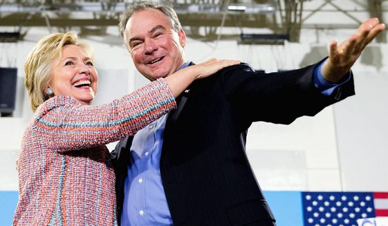 Democratic presidential candidate Hillary Clinton and running mate Sen. Tim Kaine at a rally in Virginia. (Associated press) ** FILE **