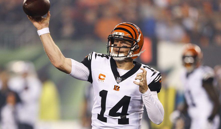 FILE - In this Thursday, Sept. 29, 2016, file photo, Cincinnati Bengals quarterback Andy Dalton throws during the first half of an NFL football game against the Miami Dolphins in Cincinnati.  Dalton is providing a suitable encore to his breakthrough season of 2015, throwing for a lot of yards with only two interceptions as the Bengals break in a new group of receivers. (AP Photo/Gary Landers, File)