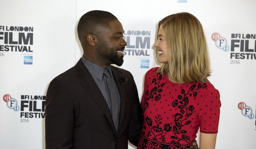 Actors David Oyelowo and Rosamund Pike pose for photographers at the photo call for the film 'A United Kingdom', which opens the London Film Festival in London, Wednesday, Oct. 5, 2016. The festival runs from Oct. 5 until Oct. 16. (Photo by Grant Pollard/Invision/AP)