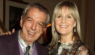 """FILE - In this March 29, 2012 file photo, songwriter Rod Temperton and his wife Kathy attending a Teenage Cancer Trust concert at the Royal Albert Hall in London. Songwriter Rod Temperton has died of cancer in London. He was 66. His music publisher said Wednesday, Oct. 5, 2016 in a statement that the man who wrote Michael Jackson's """"Thriller"""" and other hits had died last week. It did not say exactly when. (Yui Mok/PA via AP, File)"""
