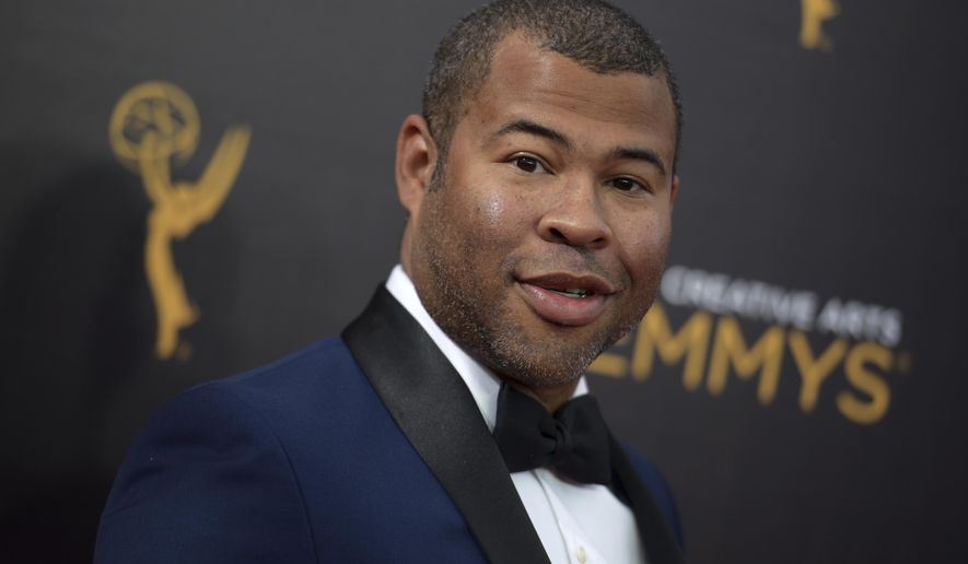"""FILE - In this Sept. 11, 2016, file photo, Jordan Peele arrives at night two of the Creative Arts Emmy Awards in Los Angeles. The trailer for Peele's upcoming film, """"Get Out,"""" debuted online on Oct. 4, 2016. (Photo by Richard Shotwell/Invision/AP, File)"""