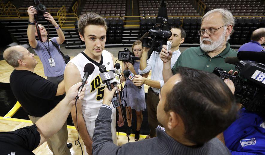 Iowa forward Nicholas Baer speaks to reporters during Iowa's annual NCAA college basketball game media day, Wednesday, Oct. 5, 2016, in Iowa City, Iowa. (AP Photo/Charlie Neibergall)