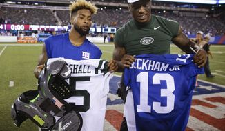 "FILE - In tihs Aug. 29, 2015, file photo, New York Giants wide receiver Odell Beckham, left, and New York Jets wide receiver Brandon Marshall, right, pose for photographs after exchanging jerseys after a preseason NFL football game in East Rutherford, N.J. Marshall says the Giants need to keep their criticisms of star Odell Beckham Jr. ""in-house"" and rally behind him.  (AP Photo/Seth Wenig, File)"
