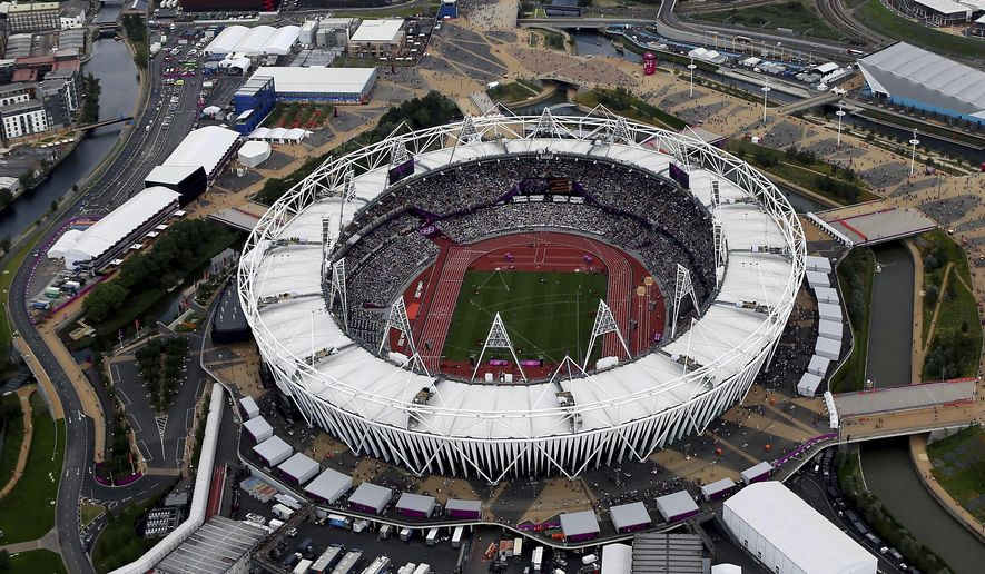 FILE - This Aug. 3, 2012, aerial file photo shows the Olympic Stadium at Olympic Park, in London. Major League Baseball Commissioner Rob Manfred said Wednesday, Oct. 5, 2016, that he remains hopeful the sport can play regular-season games at the stadium in London for the first time in 2018. (AP Photo/Jeff J Mitchell, File)