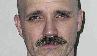 FILE - This 2005, file inmate photo provided by the New Hampshire Department of Corrections shows Cleo Roy, convicted of gunning down a Manchester, N.H., police officer Ralph Miller in 1976. The state granted parole to the Roy on Wednesday, Oct. 5, 2016, after he served 40 years of his 50-year sentence. Roy was 15 when he killed the officer. (New Hampshire Department of Corrections via AP, File)