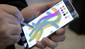 FILE - In this July 28, 2016, file photo, a color blending feature of the Galaxy Note 7 is demonstrated in New York. An overheated Samsung device created smoke that caused a plane to be evacuated at Louisville International Airport on Wednesday, Oct. 5, 2016 an official said. The smoke prompted Southwest Airlines to evacuate the plane before it departed for Baltimore, Louisville Metro Arson Capt. Kevin Fletcher told news outlets. (AP Photo/Richard Drew, File)