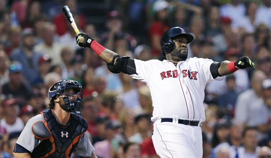 FILE - In this July 26, 2016, file photo, Boston Red Sox designated hitter David Ortiz and Detroit Tigers catcher Jarrod Saltalamacchia watch the flight of Ortiz's three-run home run during the third inning of a baseball game at Fenway Park, in Boston. Big Papi, Kris Bryant and Bryce Harper are just a few of the big-name offensive stars leading their teams into the postseason. (AP Photo/Charles Krupa, File)