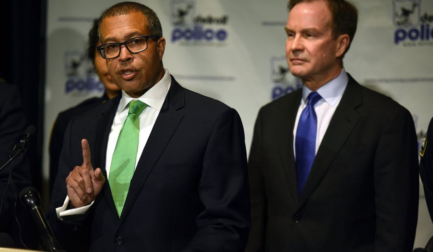 Detroit Police Chief James Craig, left, speaks at a press conference where he and Michigan Attorney General Bill Schuette, right, announced felony charges for Nheru G. Littleton, 40 of Detroit, for making threats against the lives of police officers via social media, Wednesday, Oct. 5, 2016 at the Detroit Public Safety Headquarters. (Tanya Moutzalias/The Ann Arbor News-MLive.com via AP)