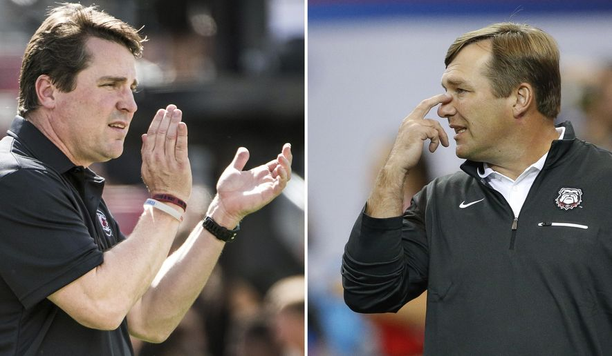 FILE - At left, in a Sept. 17, 2016, file photo, South Carolina head coach Will Muschamp communicates with players before an NCAA college football game against East Carolina, in Columbia, S.C. At right, in a Sept. 3, 2016, file photo, Georgia head coach Kirby Smart gestures as his players warm up before an NCAA college football game against North Carolina in Atlanta. Smart and Muschamp have been friends since they played safety for the Georgia Bulldogs. Now the two coaches are set to meet for the first time Saturday night with Smart back at their alma mater and Muschamp at South Carolina. (AP Photo/File)
