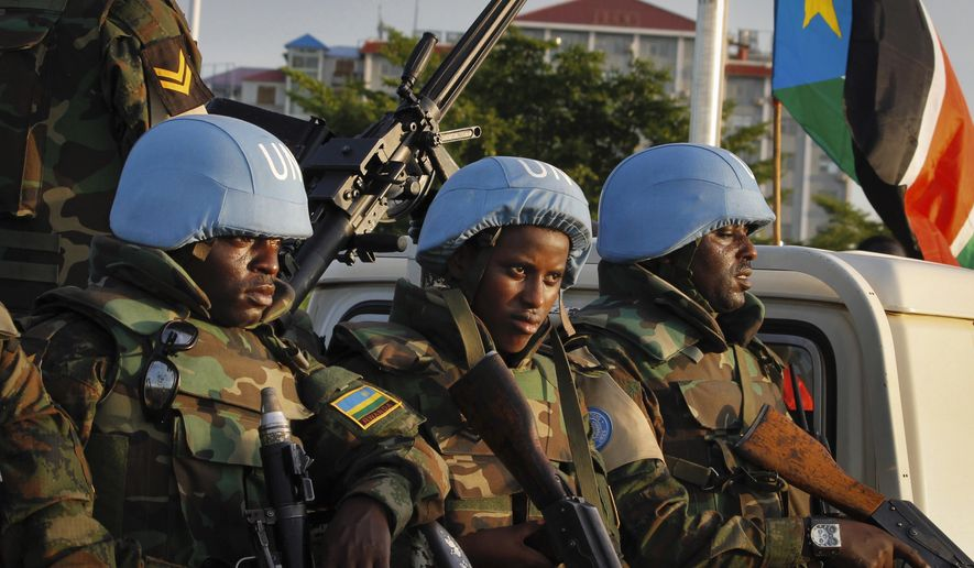 FILE - In this Friday, Sept. 2, 2016 file photo, United Nations peacekeepers from Rwanda wait to escort members of the U.N. Security Council as they arrive at the airport in the capital Juba, South Sudan. A new report says United Nations peacekeepers fled their posts when fighting erupted in South Sudan's capital in July, then used tear gas on frightened civilians who sought shelter within the U.N. base. The report on Wednesday, Oct. 5, 2016 by the U.S.-based Center for Civilians in Conflict adds to a growing list of incidents where peacekeepers have been accused of failing to carry out their mandate in South Sudan. (AP Photo/Justin Lynch, File)