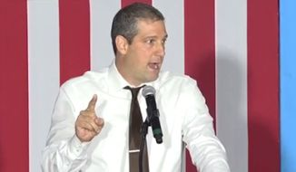 "Rep. Tim Ryan told a small crowd of labor workers in Ohio on Wednesday that Donald Trump would walk over their ""cold, dead"" bodies for his own interests. (ABC News) ** FILE **"