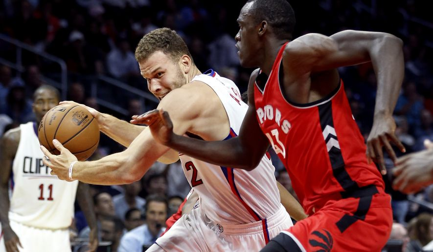 Los Angeles Clippers forward Blake Griffin, left, drives to the basket against Toronto Raptors forward Pascal Siakam (43), of Cameroon, during the first half of a preseason NBA basketball game in Los Angeles, Wednesday, Oct. 5, 2016. The Clippers won, 104-98. (AP Photo/Alex Gallardo)