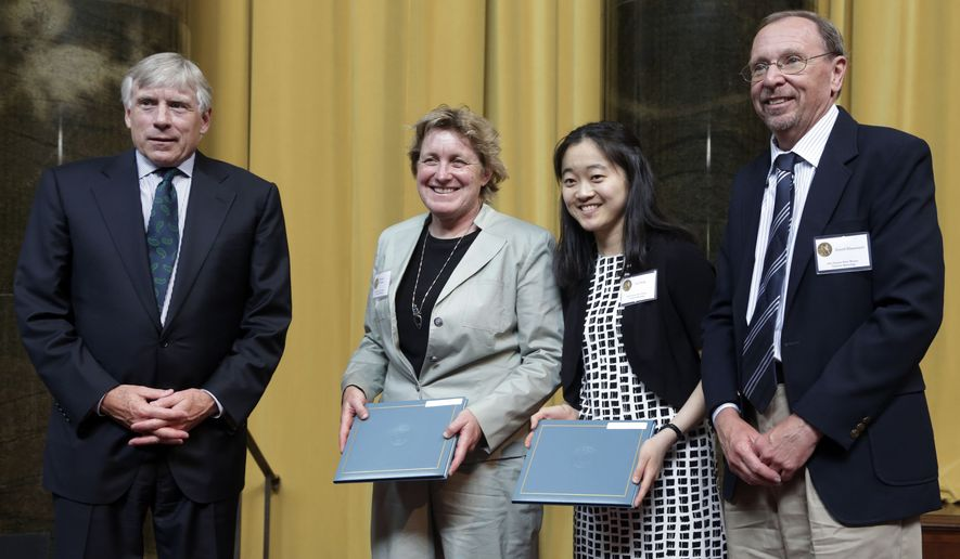 Columbia University President Lee Bollinger (left) poses with Elizabeth McGowan, Lisa Song and David Hasemyer of InsideClimate News — winners of the 2013 Pulitzer Prize for National Reporting — during the award ceremony at Columbia University's Law Library on May 30, 2013, in New York. (Associated Press)