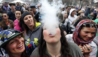 Partygoers dance and smoke pot at the annual 4/20 marijuana festival in Denver on April 19, 2014. (Associated Press)
