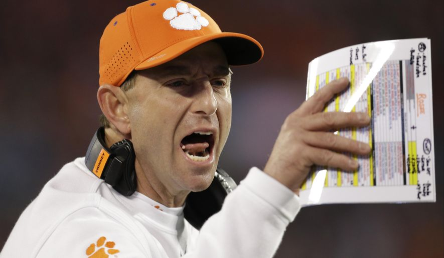 FILE - In this Dec. 5, 2015, file photo, Clemson head coach Dabo Swinney directs his team against North Carolina during the first half of the Atlantic Coast Conference championship NCAA college football game in Charlotte, N.C. Swinney might have to tell his players to B.Y.O.E to Boston College on Friday night: Bring your own energy. Literally and figuratively, Chestnut Hill, Massachusetts, is a long way from Death Valley.(AP Photo/Bob Leverone, File)