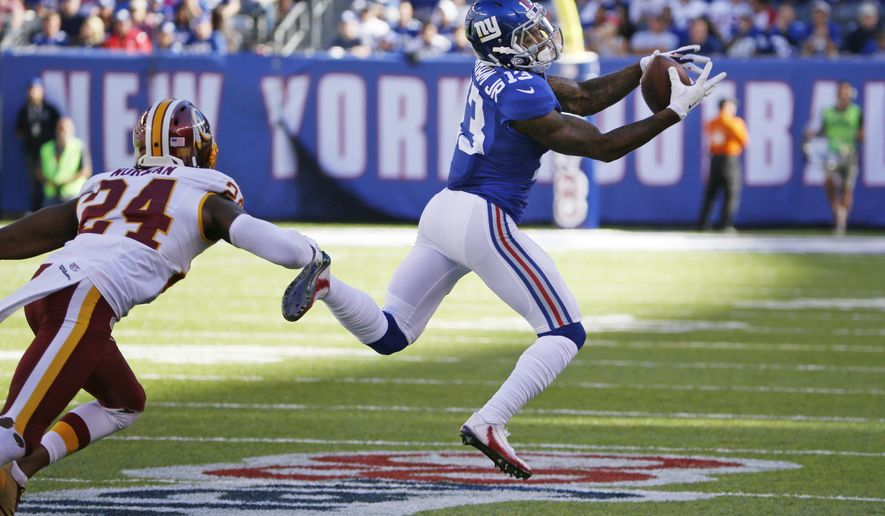 FILE - In this Sunday, Sept. 25, 2016, file photo, New York Giants wide receiver Odell Beckham (13) catches a pass in front of Washington Redskins' Josh Norman (24) during the second half of an NFL football game in East Rutherford, N.J. Maybe Beckham will start making headlines again for his receiving talents when the Giants visit the Green Bay Packers on Sunday night.Because this week, the chatter around the league about Beckham has mainly been about the wideout's tantrums. (AP Photo/Kathy Willens, File)
