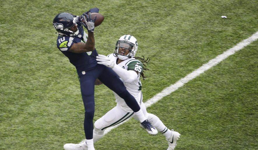 """FILE - In this Oct. 2, 2016, file photo, Seattle Seahawks wide receiver Paul Richardson catches a pass in front of New York Jets' Calvin Pryor (25) during an NFL football game in East Rutherford, N.J.  """"There's a target on our backs in the secondary,"""" Pryor said. """"We're definitely a part of the problem that's going on right now."""" The Jets are allowing an average of 285 yards passing per game, ranking them seventh in the NFL in that category. New York is tied for third with 17 pass plays of 20 or more yards, and the Jets are first--or, last, in this case--with seven pass plays allowed of 40 or more yards. (AP Photo/Peter Morgan, File)"""