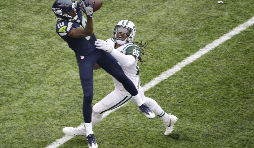 "FILE - In this Oct. 2, 2016, file photo, Seattle Seahawks wide receiver Paul Richardson catches a pass in front of New York Jets' Calvin Pryor (25) during an NFL football game in East Rutherford, N.J.  ""There's a target on our backs in the secondary,"" Pryor said. ""We're definitely a part of the problem that's going on right now."" The Jets are allowing an average of 285 yards passing per game, ranking them seventh in the NFL in that category. New York is tied for third with 17 pass plays of 20 or more yards, and the Jets are first--or, last, in this case--with seven pass plays allowed of 40 or more yards. (AP Photo/Peter Morgan, File)"