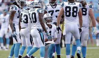 ADVANCE FOR WEEKEND EDITIONS, OCT. 8-9- FILE - In this Sunday, Sept. 18, 2016, file photo, Carolina Panthers' Cam Newton (1) kneels in the huddle as he tries to find a way to score against the Minnesota Vikings during the second half of an NFL football game in Charlotte, N.C. It's gotten ugly early in Arizona, Carolina, Indianapolis, Miami, New Orleans, Detroit and the Jersey Meadowlands. All of those teams, the Jets in the Big Apple, are 1-3(AP Photo/Bob Leverone, File)
