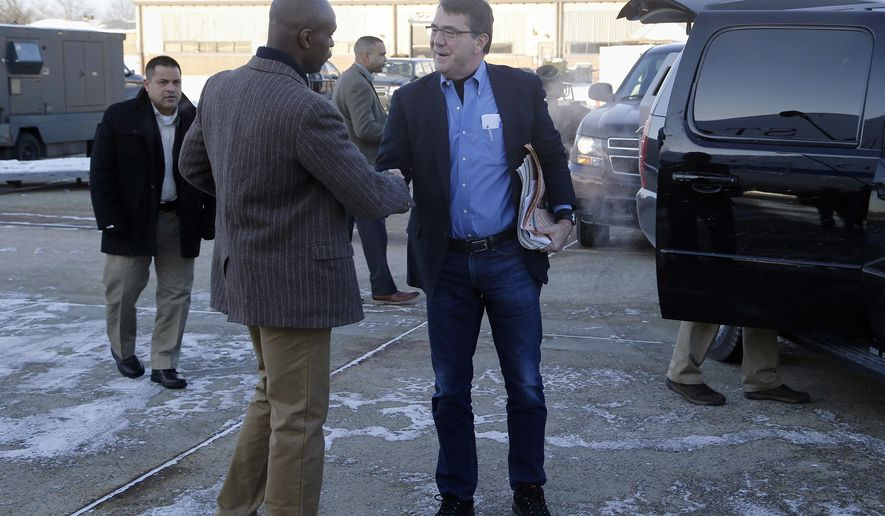 "FILE - In this Feb. 20, 2015, file photo, U.S. Secretary of Defense Ash Carter, center, is greeted by Senior Military Assistant U.S. Army Maj. Gen. Ron Lewis as they arrive at Andrews Air Force Base, Md., to travel to Afghanistan. A Pentagon investigation concluded that Lewis, Carter's former senior military aide, used his government credit card at strip clubs or gentlemen's clubs in Rome and Seoul, drank in excess and had ""improper interactions"" with women, The Associated Press has learned. (Jonathan Ernst/Pool Photo via AP, File)"