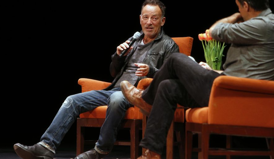 """In this photo taken Wednesday, Oct. 6, 2016, musician Bruce Springsteen talks about his book """"Born to Run"""" with Dan Stone, right, during an event at the Nourse Theater in San Francisco. Springsteen credits his music with helping him navigate depression, and says playing marathon shows until he was exhausted helped chase away the blues.Springsteen spoke to an adoring, sold-out crowd on Wednesday night, in a 1-hour, 20-minute on-stage interview as part of a nationwide tour for his best-selling new autobiography. (Scott Strazzante/San Francisco Chronicle via AP)"""