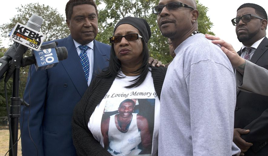FILE - In this Oct. 3, 2016 file photo Robert Mann, right, the brother of Joseph Mann who was killed by Sacramento police in July, discusses the shooting of his brother during a news conference in Sacramento, Calif.  The Mann family say Joseph was mentally ill at the time he was shot and killed by two Sacramento police officers.  A spate of deadly encounters between police and mentally troubled suspects in recent weeks has cast a spotlight on law enforcement's mounting responsibilities for dealing with the mentally ill.  Also seen is attorney John Burris, left, and Deborah Mann, sister of Robert and Joseph. (AP Photo/Rich Pedroncelli, File)