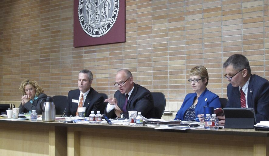 Wyoming Gov. Matt Mead, center, asks questions about loan applications during a State Loan and Investment Board meeting in Cheyenne, Wyo., on Thursday, Oct. 6, 2016. Board members, from left, State Superintendent of Public Instruction Jillian Balow, Secretary of State Ed Murray, Gov. Mead, State Auditor Cynthia Cloud, and State Treasurer Mark Gordon. (AP Photo/Ben Neary)