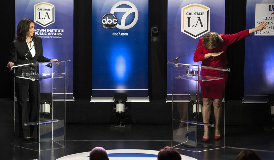 "In this Wednesday, Oct. 5, 2016 photo, Rep. Loretta Sanchez, D-Orange, right, does the ""dab"" at the conclusion of her debate with state Attorney General Kamala Harris in Los Angeles. The Orange County congresswoman capped the hour-long event with her fellow Democrat by mimicking a celebratory gesture popularized by NFL star Cam Newton. (Ed Crisostomo/The Orange County Register via AP)"