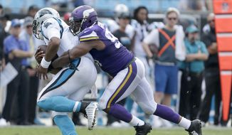 FILE - In this Sept. 18, 2016, file photo, Carolina Panthers' Cam Newton (1) can't get out of a sack by Minnesota Vikings' Everson Griffen (97) during the second half of an NFL football game in Charlotte, N.C.  The Houston Texans and Minnesota Vikings are among the teams with the top records in the NFL winning with defense first and quarterback second. (AP Photo/Bob Leverone, File)