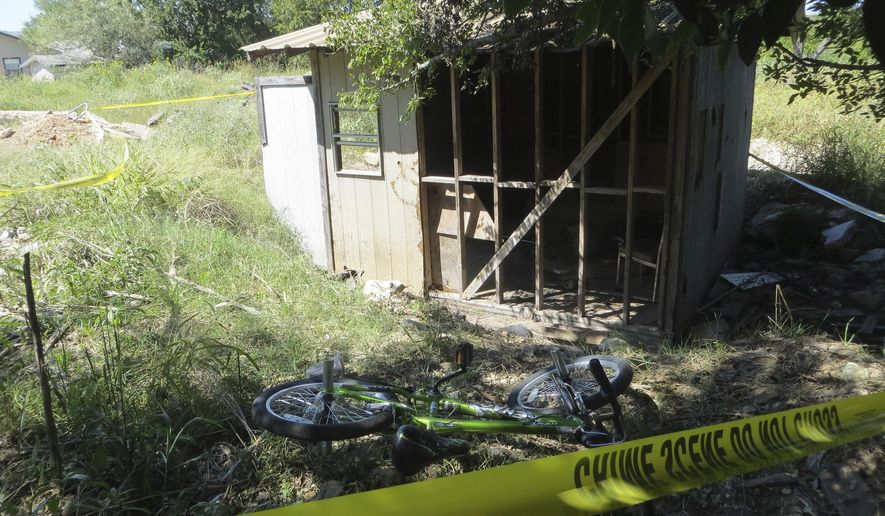 """Police tape blocks of the location of a fire on Wednesday, Oct. 5, 2016 in Kerrville, Texas.   A Texas juvenile has been charged with arson after police say he tossed aside a burning gas canister that struck and seriously burned a 10-year-old boy. City officials in Kerrville, 70 miles northwest of San Antonio, said in a statement Wednesday that the juvenile is """"responsible for causing the victim's severe burns."""" Officials haven't released the identity of the juvenile, who is charged with first-degree arson.  (Zeke MacCormack/The San Antonio Express-News via AP)"""
