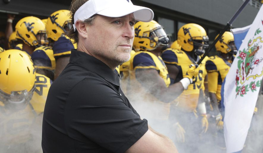 FILE - In this Oct. 1, 2016, file photo, West Virginia head coach Dana Holgorsen  waits to take the field before an NCAA college football game against Kansas State, in Morgantown, W.Va. West Virginia has this week off before playing at Texas Tech on Oct. 15.  (AP Photo/Raymond Thompson, File)