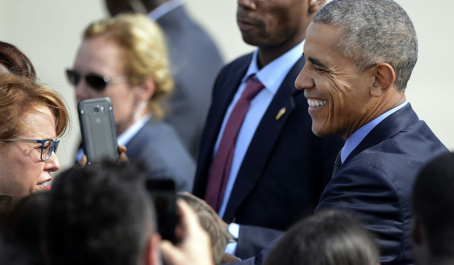 President Barack Obama greets supporters after arriving at O'Hare International Airport Friday, Oct. 7, 2016, in Chicago. (AP Photo/Paul Beaty)