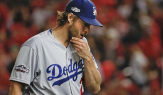 Los Angeles Dodgers starter Clayton Kershaw was able to pick up a win in Game 1 of the NLDS despite lasting just five innings. / AP photo