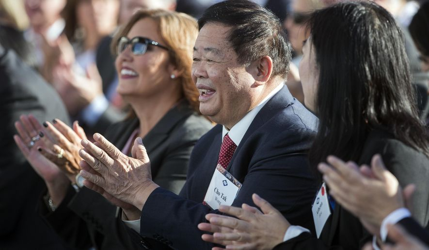 Cho Tak Wong, chairman of the Fuyao Group, applauds during the grand opening of the Fuyao Glass America plant, Friday, Oct. 7, 2016, in Moraine, Ohio. The Chinese company is ready to show off its completed automotive glass-making plant in Ohio, which serves as its North American hub for recycled glass manufacturing. (AP Photo/John Minchillo)