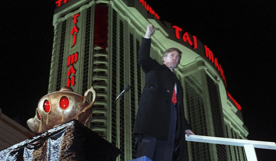 FILE  - In this April 5, 1990 file photo, Donald Trump raises his fist during ceremonies for the opening the Trump Taj Mahal Casino Resort in Atlantic City, N.J. The man who is now the Republican presidential nominee has been mostly gone from Atlantic City since 2009, when a well-publicized decline was starting its third year. And early Monday, Oct. 10, 2016, the last vestige of Donald J. Trump will vanish from Atlantic City when the new owner of the Trump Taj Mahal casino shuts it down. (AP Photo/Charles Rex Arbogast, File)
