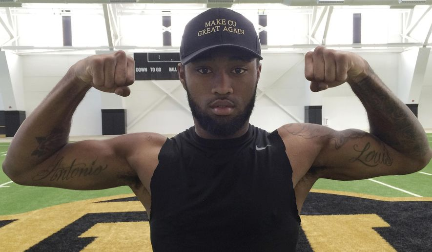 In this Tuesday, Oct. 4, 2016, photo,, Colorado wide receiver Bryce Bobo flexes his muscles in Boulder, Colo., to show tattoos on his biceps that pay homage to his father, Antonio Louis Bobo, who was shot and killed when the football player was 4 years old. The Colorado junior has made two big one-handed catches so far this season. (AP Photo/Pat Graham)