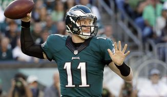 FILE - In this Sept. 25, 2016, file photo, Philadelphia Eagles' Carson Wentz passes during the first half of an NFL football game against the Pittsburgh Steelers in Philadelphia. Philadelphia (3-0) has one of the NFL's top-ranked defenses and rookie quarterback Wentz is playing mistake-free football. (AP Photo/Chris Szagola, File)