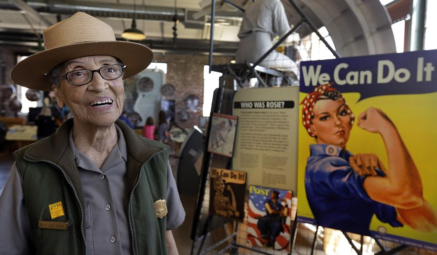 FILE - In this July 12, 2016, file photo, National Park Service Ranger Betty Reid Soskin smiles at the Rosie the Riveter World War II Home Front National Historical Park in Richmond, Calif.  The nation's oldest park ranger will be awarded a Congressional Record statement Friday, Oct. 7, 2016, at the museum and national historic park where she works in Richmond. (AP Photo/Ben Margot, file)