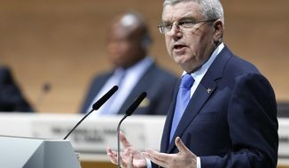 FILE - This is a  Friday, Feb. 26, 2016 file photo of IOC President Thomas Bach as he speaks during the extraordinary FIFA congress in Zurich, Switzerland, Friday, Feb. 26, 2016. With the Russian doping scandal still causing discord across the international sports world, Olympic leaders will meet Saturday to consider ways of revamping a global drug-testing system battered by political disputes and a loss of public confidence.  (AP Photo/Michael Probst File)