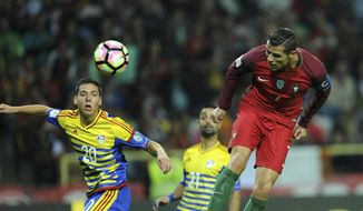 Portugal's Cristiano Ronaldo, right, scores his team's second goal past Andorra's Max Llovera during their World Cup Group B qualifying match at the Municipal Stadium in Aveiro, Portugal on Friday Oct. 7, 2016. (AP Photo/Paulo Duarte)