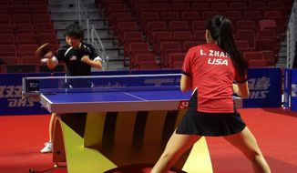 In this image from video, Yue Wu, of the United States, hits the ball during a practice match against countrywoman Lily Zhang, Thursday, Oct. 6, 2016, in Philadelphia. The Women's Table Tennis World Cup in Philadelphia this weekend is the first time the event is being held in the United States. (AP Photo/Dake Kang)