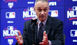 Major League Baseball Commissioner Rob Manfred decided early on Saturday to postpone Game 2 of the NLDS. / AP photo