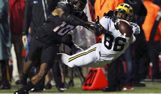 Michigan wide receiver Jehu Chesson (86) cannot reach a pass as Rutgers defensive back Blessaun Austin (10) defends during the first half of an NCAA college football game Saturday, Oct. 8, 2016, in Piscataway, N.J. (AP Photo/Mel Evans)