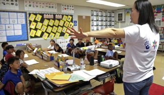In this Sept. 30, 2016 photo, teacher Regina Yang leads a bilingual Korean-English language immersion classes at Porter Ranch Community School in Los Angeles. As the rest of America debates stringent limits on immigration, California voters are considering going the other direction: They will decide whether to repeal a nearly two-decade-old prohibition that bars schools from teaching English learners in any language other than English. Proposition 58 has drawn virtually no attention, unlike the division sowed in 1998 when the original initiative went before voters. (AP Photo/Nick Ut)