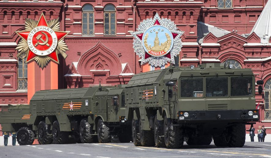 FILE - In this file photo taken on Saturday, May 9, 2015, Iskander missile launchers are driven during the Victory Parade marking the 70th anniversary of the defeat of the Nazis in World War II, in Red Square in Moscow. Poland and Estonia expressed concerns Saturday, Oct. 8, 2016, that Russia has moved nuclear-capable Iskander ballistic missiles into Kaliningrad, a Russian region on the Baltic Sea, with one official saying Russia appears eager to dominate that body of water. (AP Photo/Alexander Zemlianichenko, file)