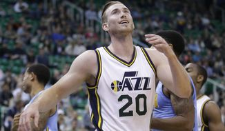 FILE - In this Oct. 22, 2015, file photo, Utah Jazz guard Gordon Hayward reacts after committing a foul during the team's NBA preseason basketball game against the Denver Nuggets in Salt Lake City. Hayward fractured a finger on his left hand during practice Friday, Oct. 7, 2016, the team said. The team said the 26-year-old Hayward will be evaluated further by the Jazz medical staff. (AP Photo/Rick Bowmer, File)