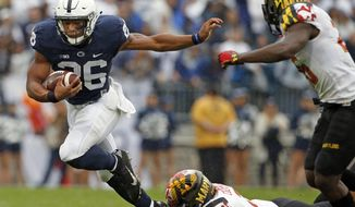 Penn State's Saquon Barkley (26) is tackled by Maryland's Shane Cockerille (2) during the first half of an NCAA college football game in State College, Pa., Saturday, Oct. 8, 2016. (AP Photo/Chris Knight)