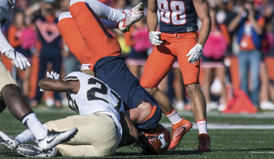 Illinois quarterback Chayce Crouch (7) is upended by Purdue safety Navon Mosley (27) during the first half of an NCAA college football game Saturday, Oct. 8, 2016, in Champaign, Ill.  (AP Photo/Bradley Leeb)