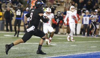 Tulsa quarterback Dane Evans (9) runs into the end zone with the game-winning touchdown in overtime of an NCAA college football game against SMU in Tulsa, Okla., Friday, Oct. 7, 2016. Tulsa won 43-40. (AP Photo/Sue Ogrocki)